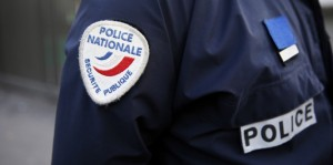 This picture taken on January 13, 2014 shows a badge of the French police on the uniform of a policeman during a patrol in a Zone de Securite Prioritaire (ZSP, Priority Security Zone) in Sarcelles, a Parisian suburb. AFP PHOTO / PATRICK KOVARIK